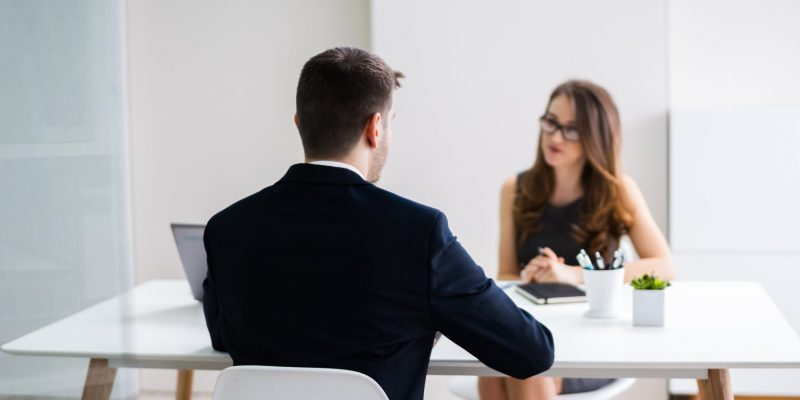 Man Sitting At Job Interview In Office